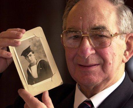 Albert 'Joe' Barnes with a photo of himself