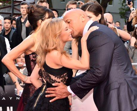 Kylie Minogue and Dwayne Johnson kiss