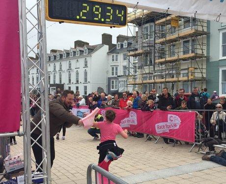 A runner crosses the finish line