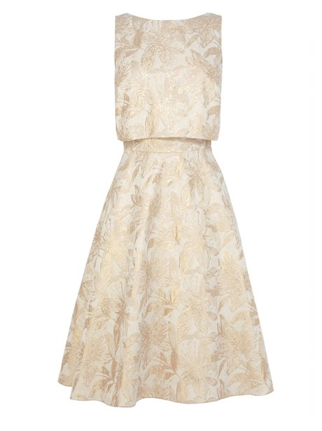 A white and gold frock