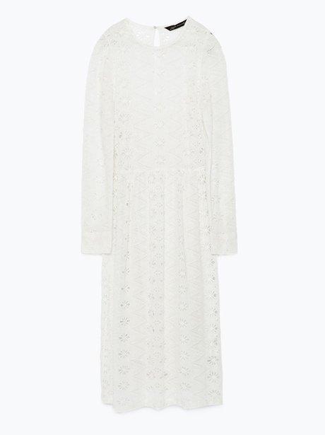 A long sleeve white dress