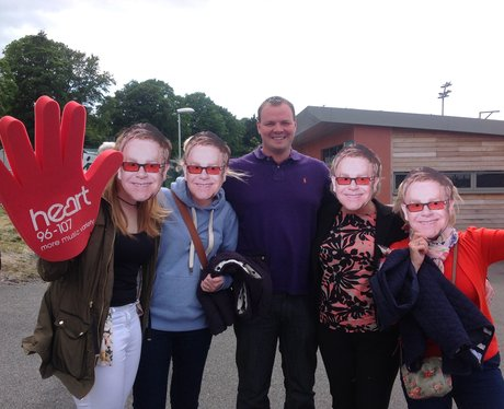 A group with Elton John masks