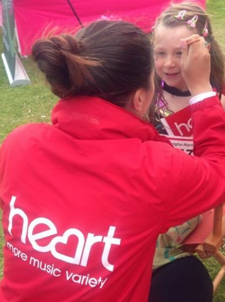 heart angel painting a childs face