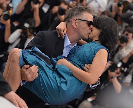 Alec Baldwin kisses wife Hilaria Thomas.