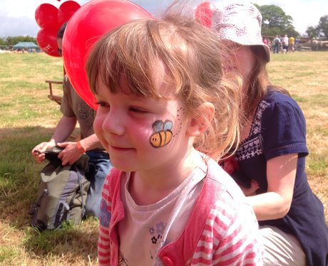 A little girl with her face painted