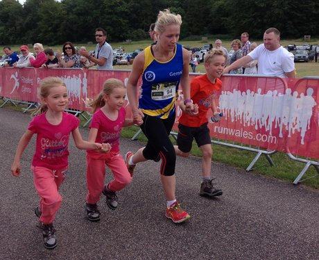 A lady finishes the race joined by her children