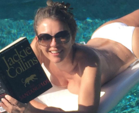 liz hurley reading in pool instagram