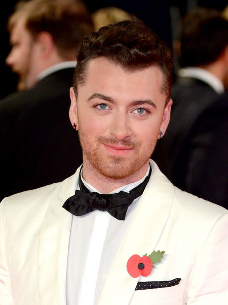 Sam Smith in a white tuxedo