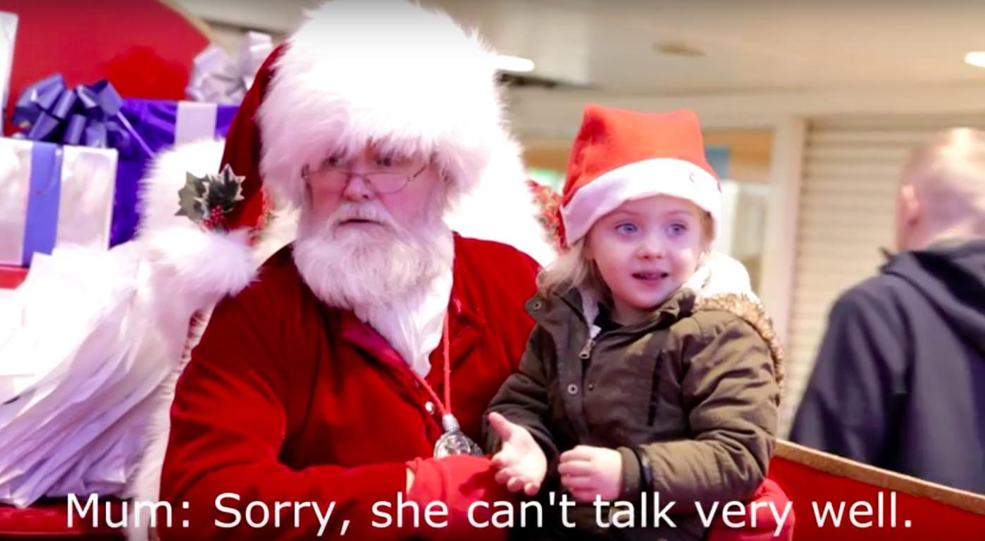 Santa speaks to deaf child