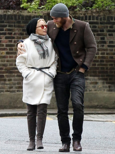 Kylie Minogue and fiancé Joshua Sasse walking