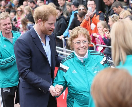 Prince Harry helps Sylvia Disley when she trips