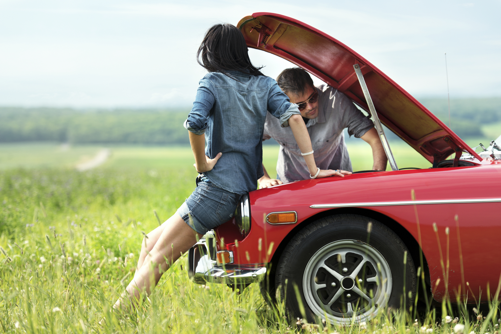 couple with broken down car
