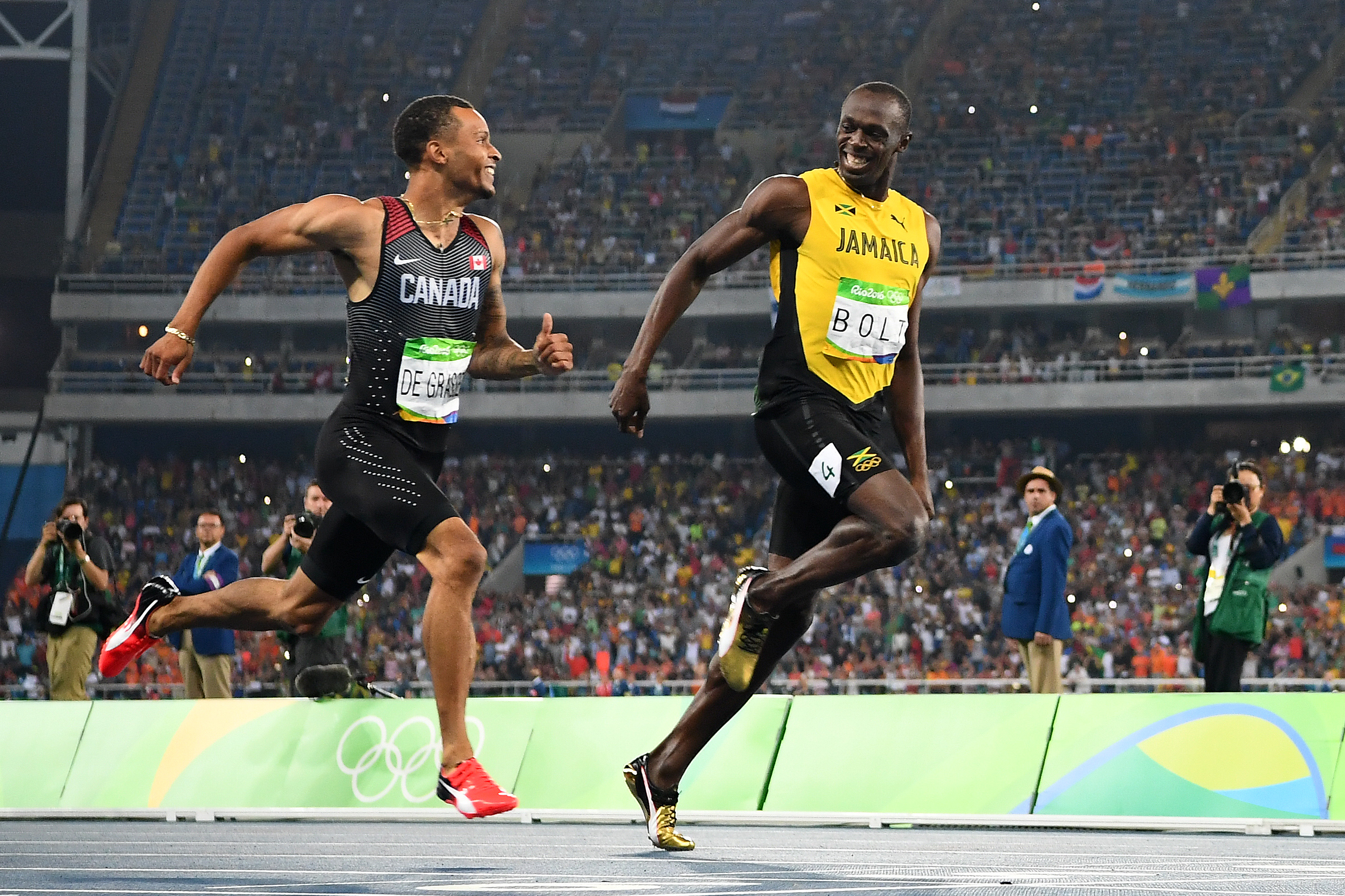 usain bolt shares joke with andre de grass