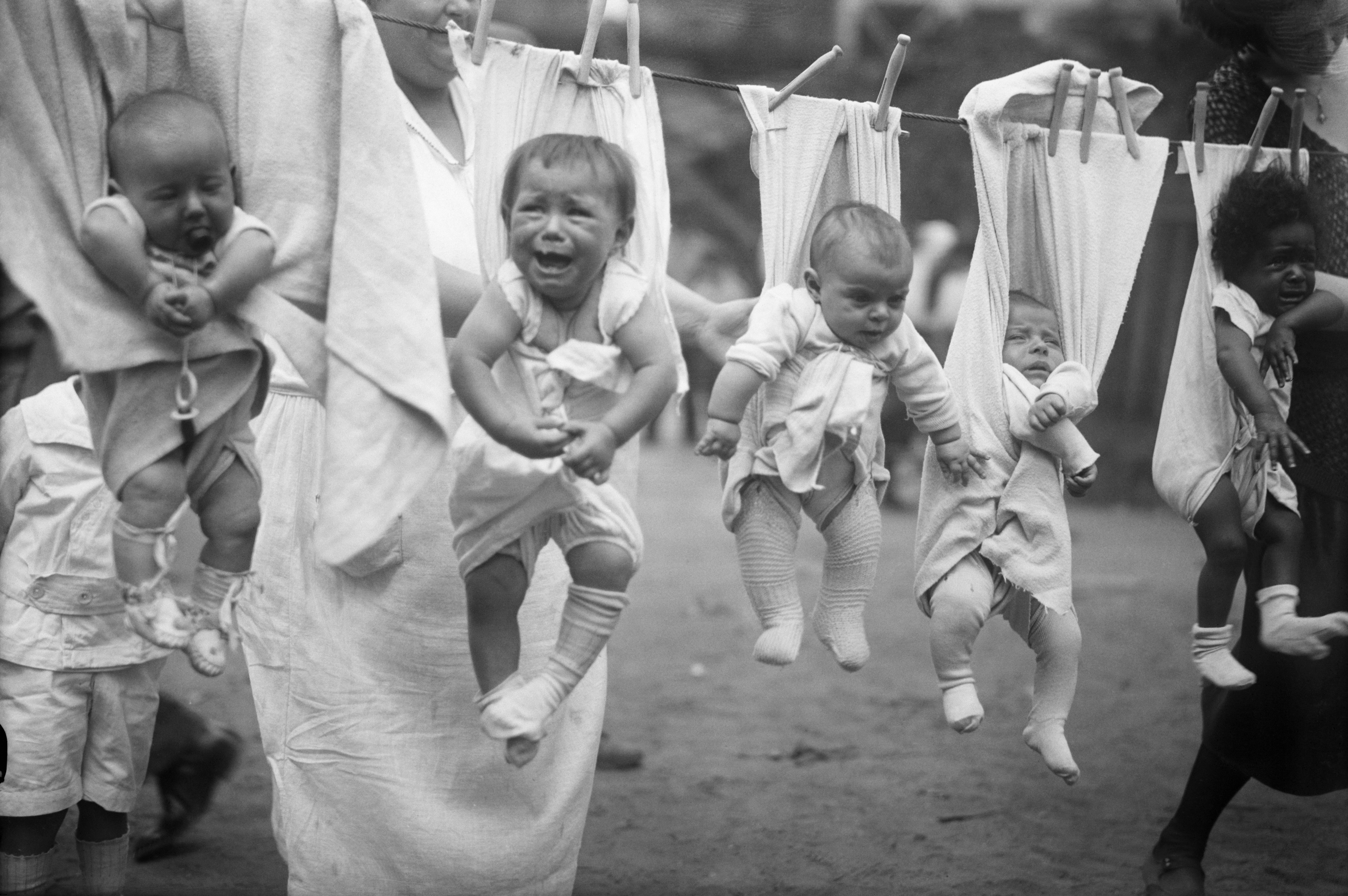 Babies hanging with laundry on washing line
