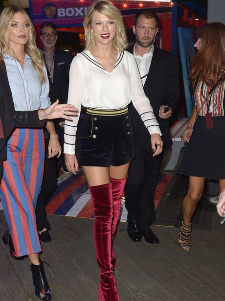 Taylor Swift Stuns In Thigh-High Red Boots At NYFW