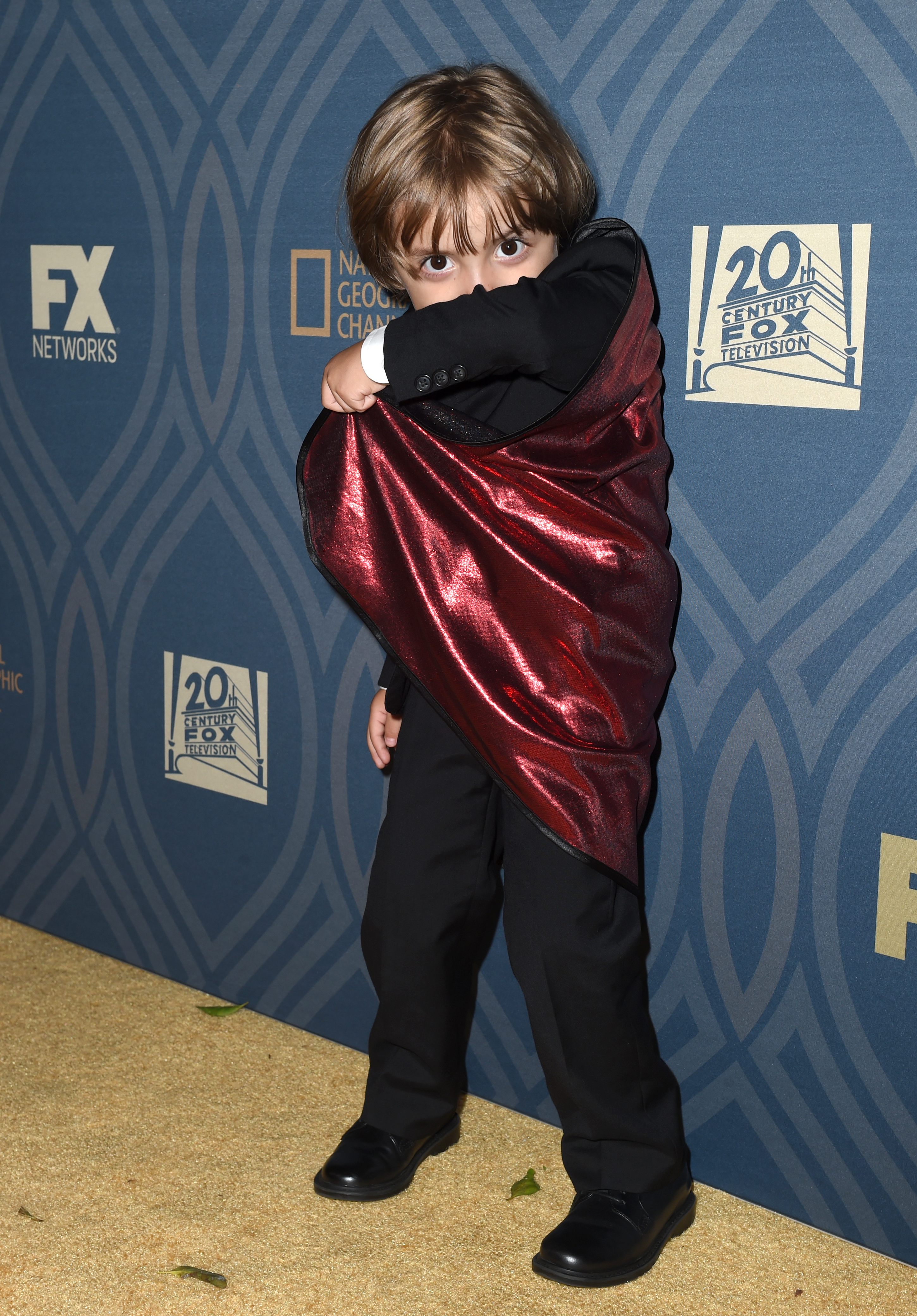 Jeremy McGuire Wears Cape At The Emmys