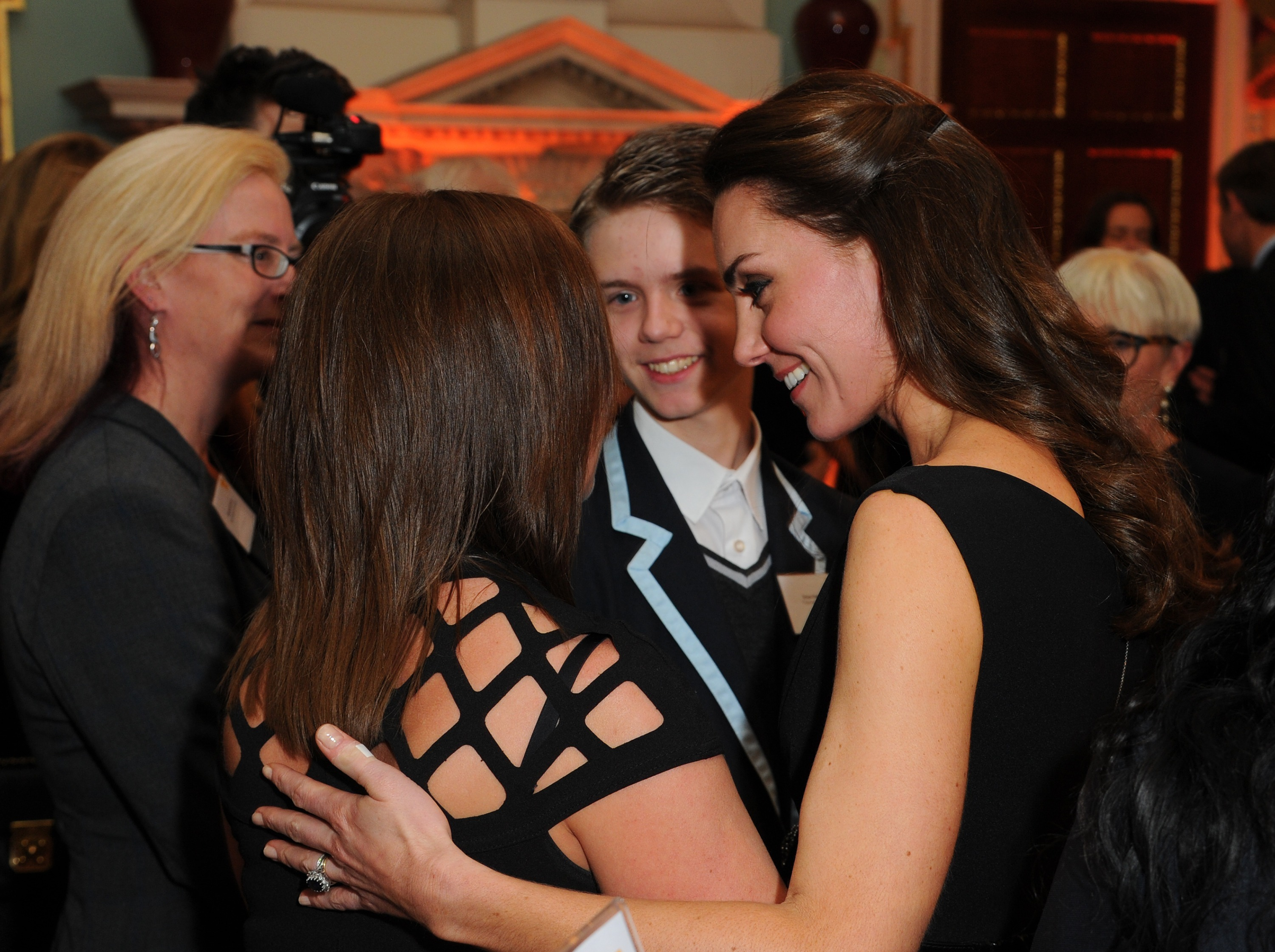 Kate Middleton hugs fellow mother