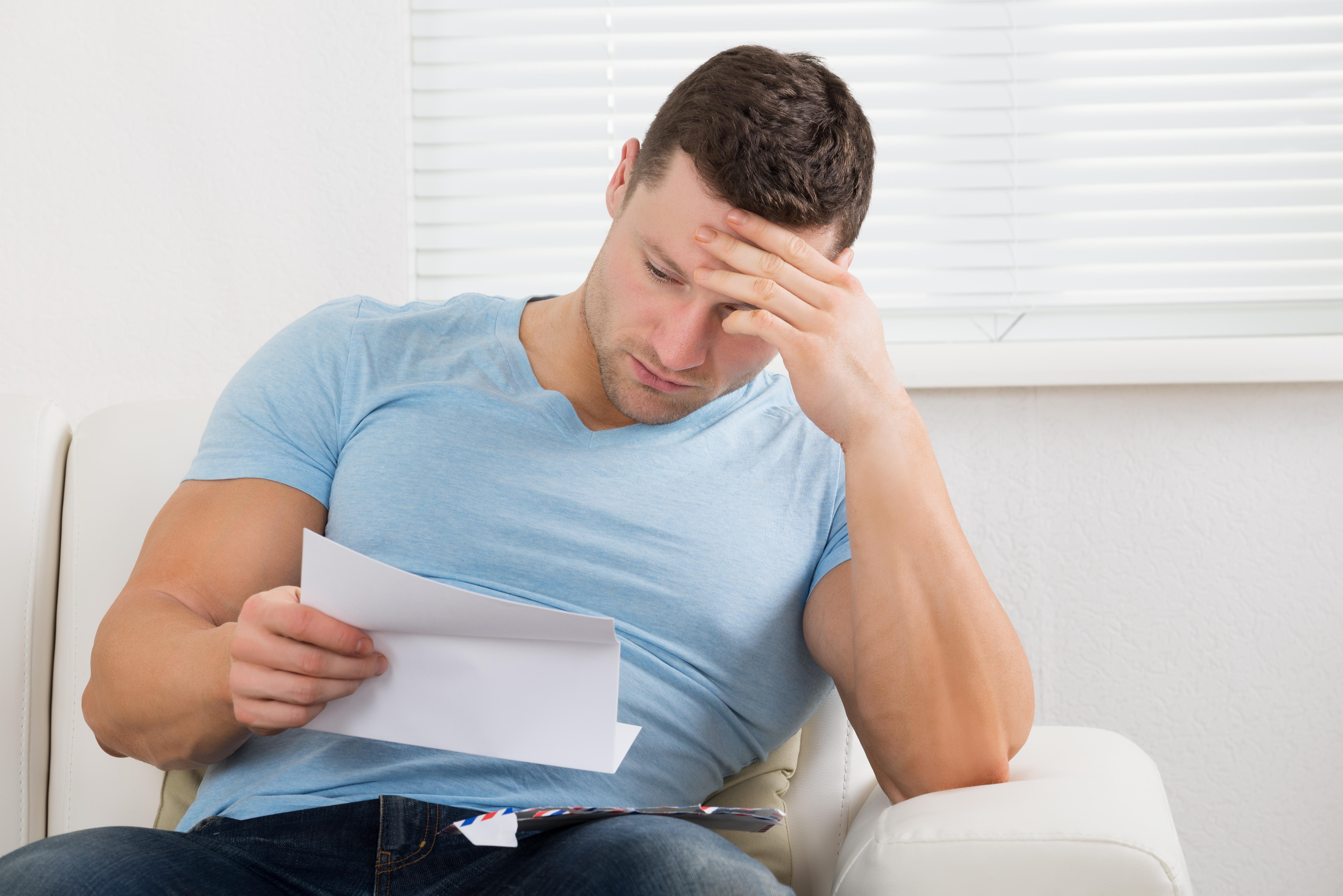 man reading letter