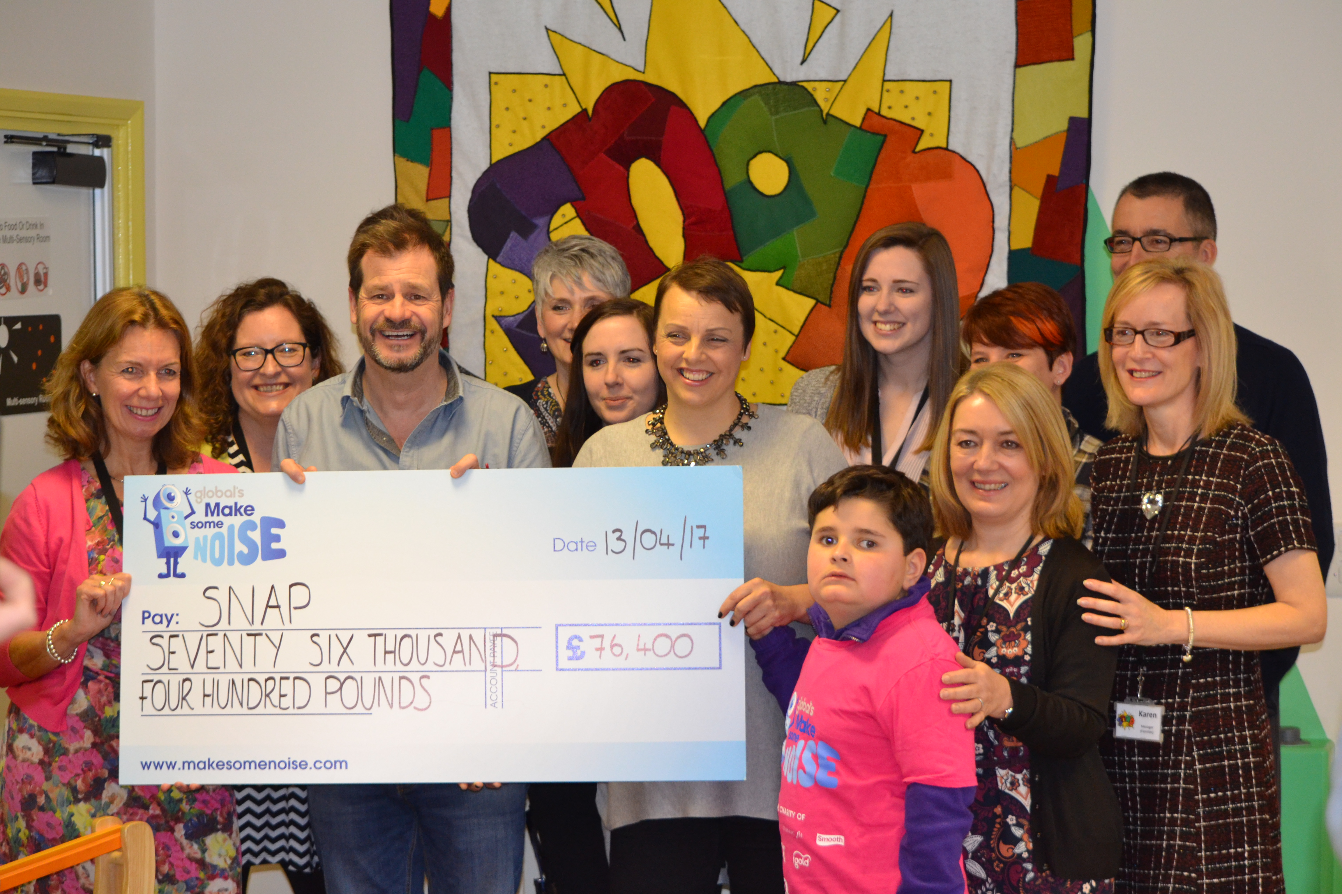 Martin and Su present a cheque to SNAP