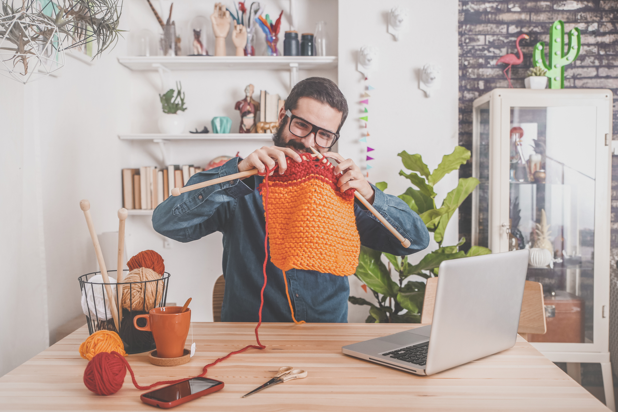 Man learning to knit