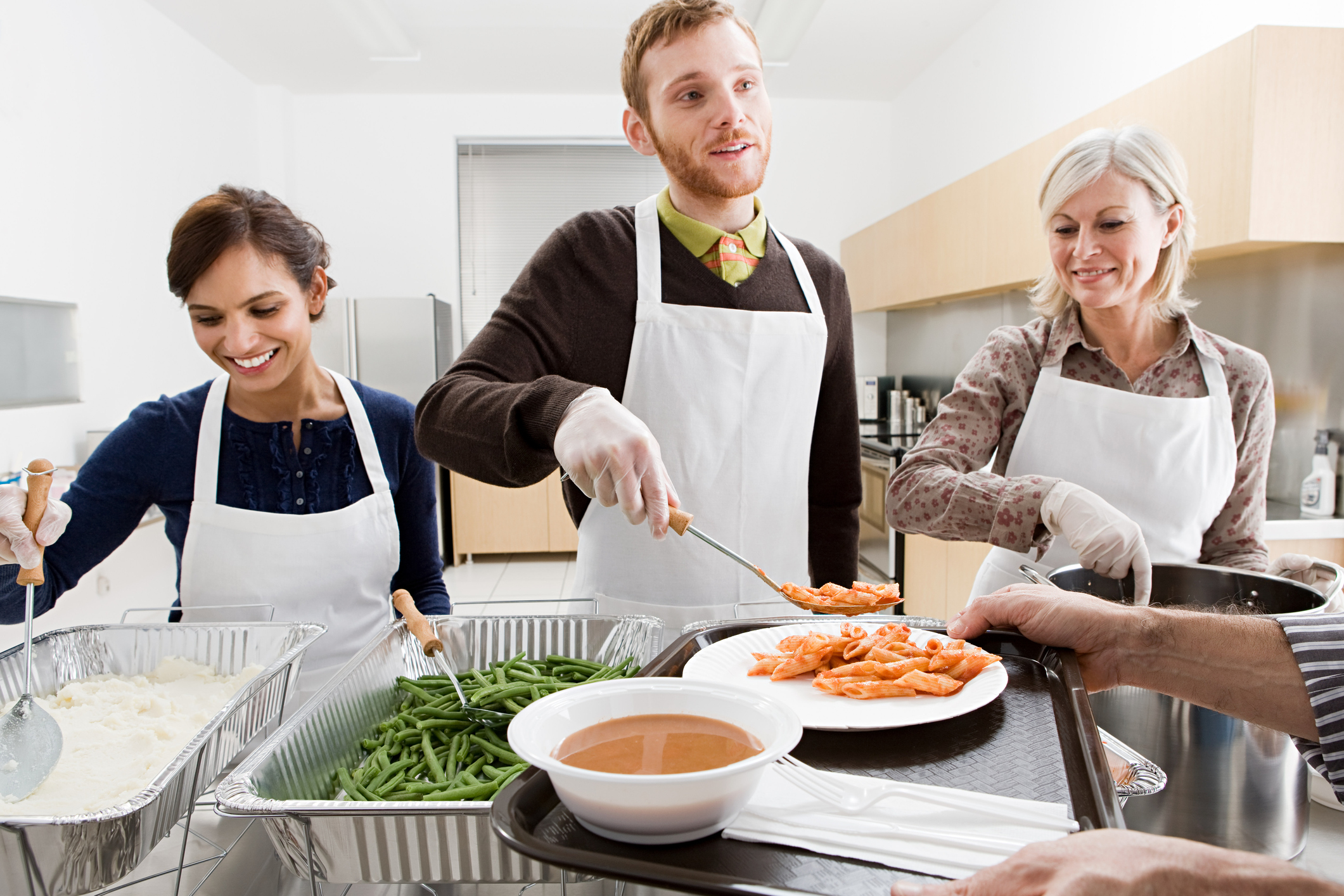 Group of people volunteering in soup kitchen