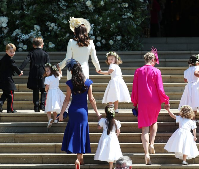 The Duchess of Cambridge (front left) arrives with