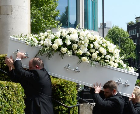 Dale Winton's coffin is carried in to Old Church i