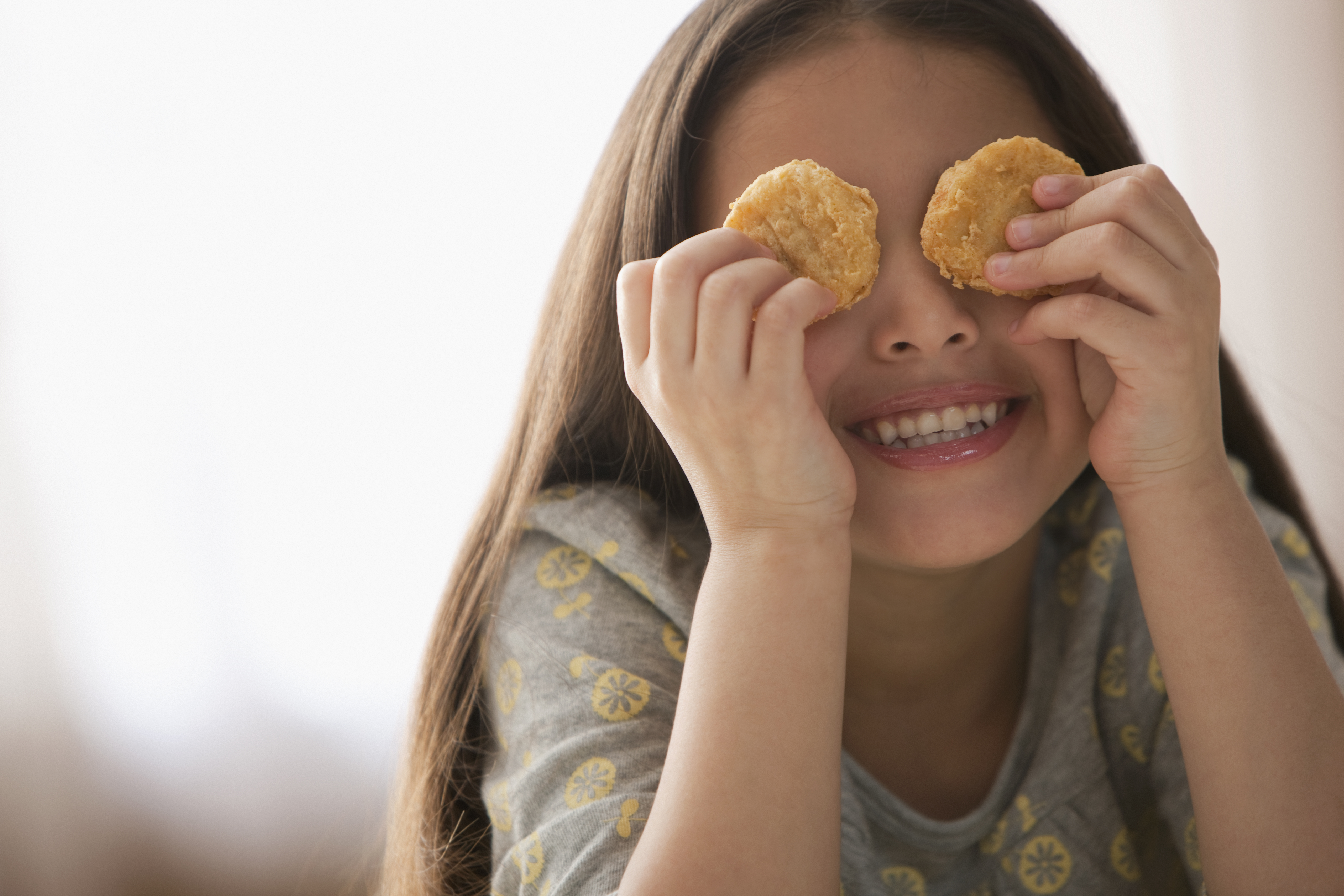 kid with nuggets