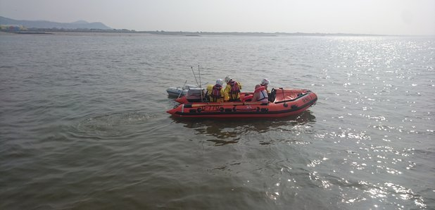 Dad and son in a dingy rescued from a shipping lane off Welsh coast