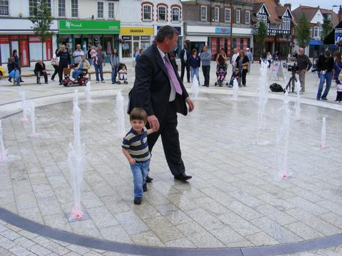 Father and son in fountains in Letchworth